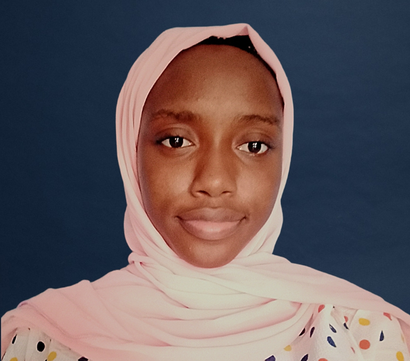 A young woman in a pink hijab